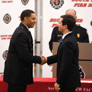 Mayor Pete shakes hands with a firefighter during Fire Recruit Graduation
