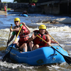 City Employees raft on the East Race during a City Wellness event